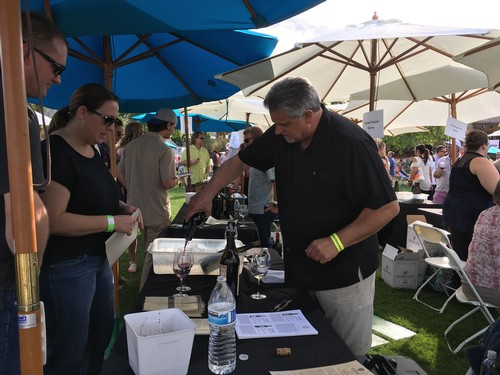 Pouring wine at Ranhco Mirage Food and Wine Festival