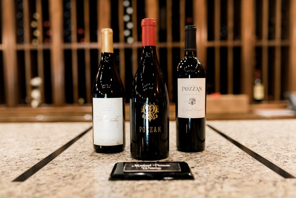 Three bottles of wine presented on a marble table